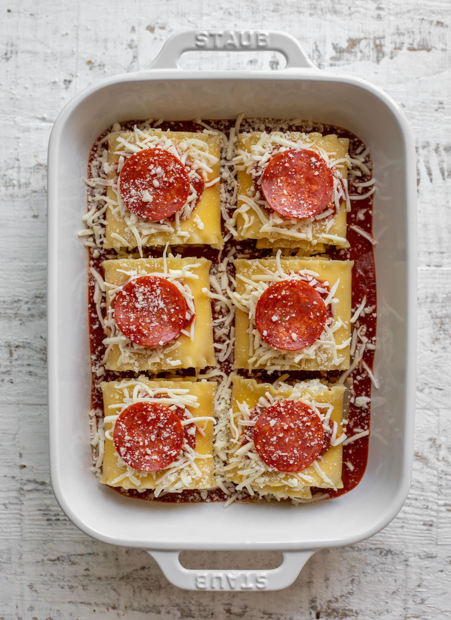 pepperoni pizza lasagna roll ups ready for the oven