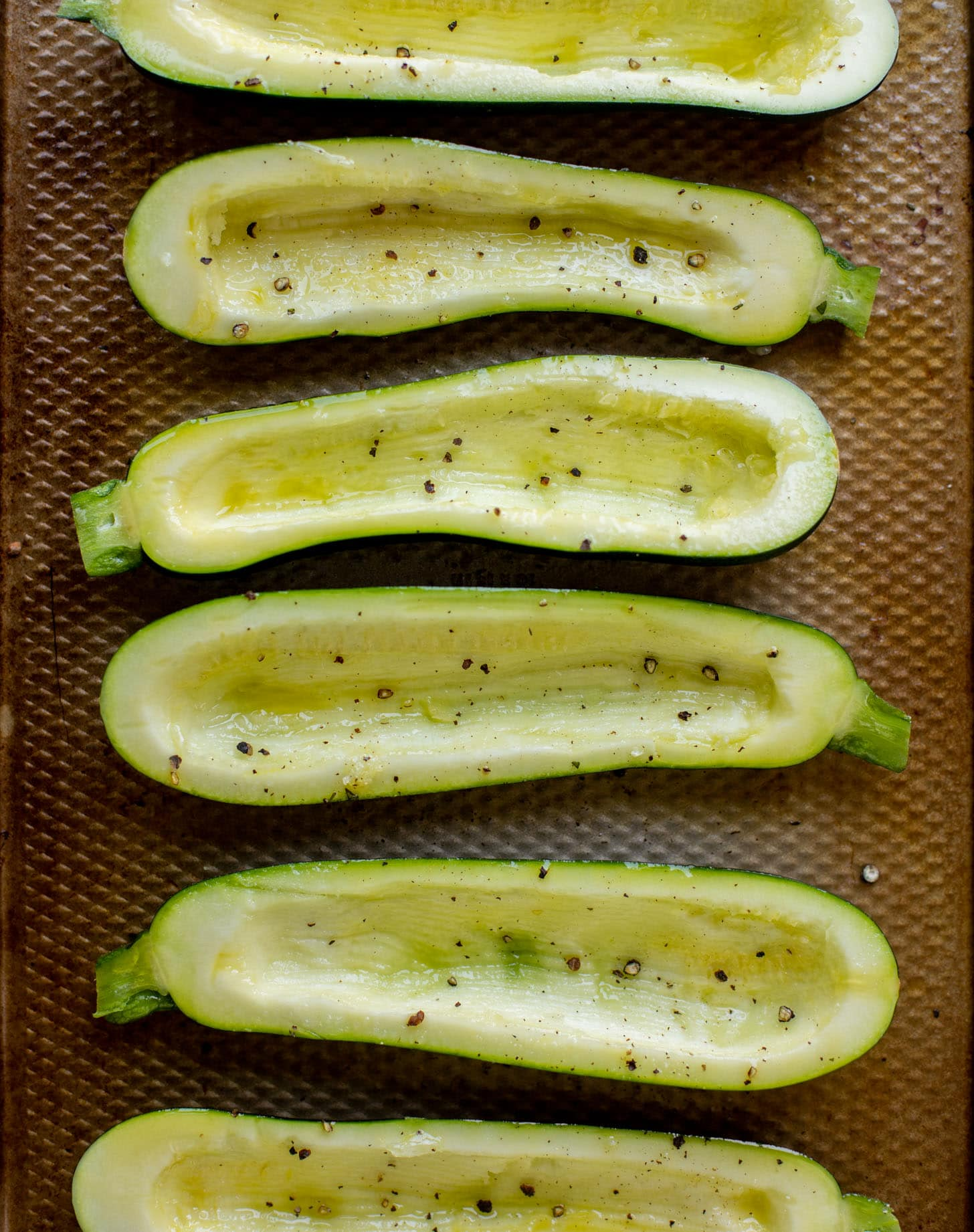 sliced zucchini with salt and pepper