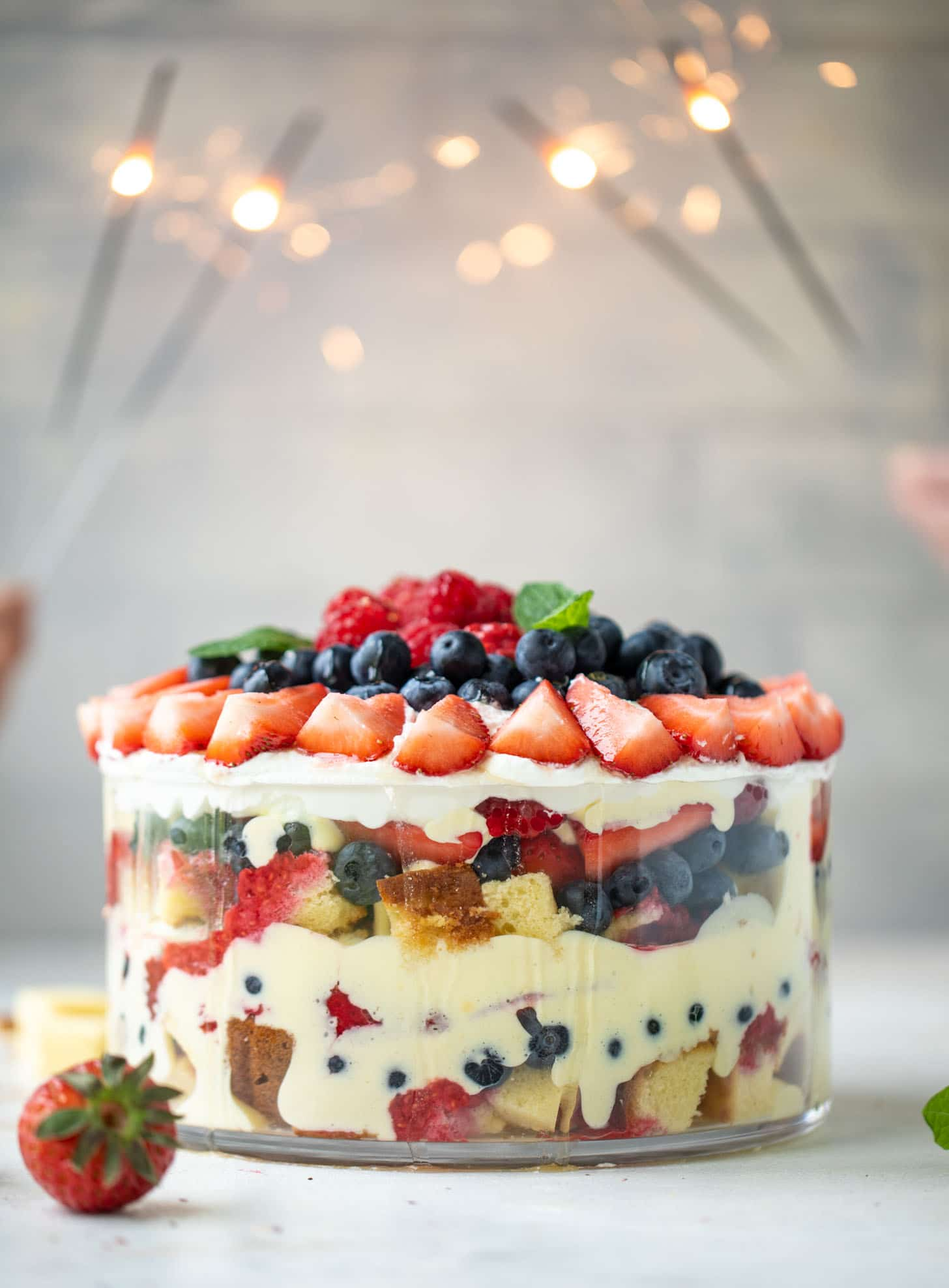 red white and blue berry trifle with raspberry sauce
