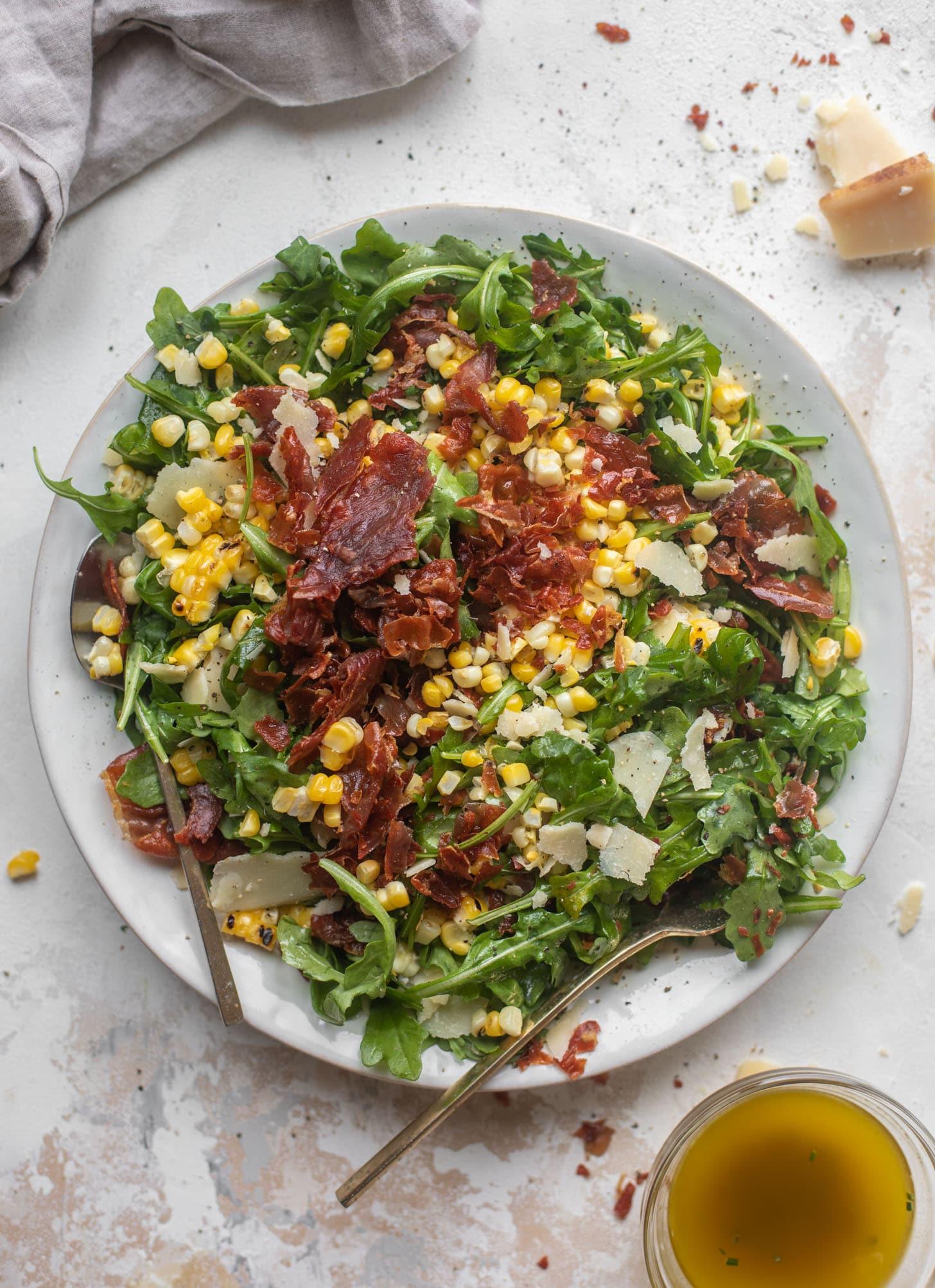 crispy prosciutto & charred corn arugula salad