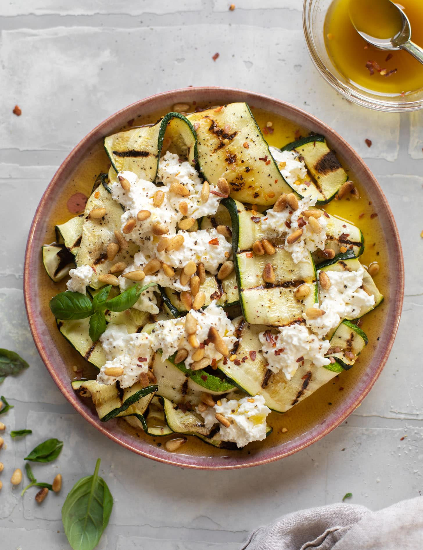 grilled zucchini with burrata and pine nuts