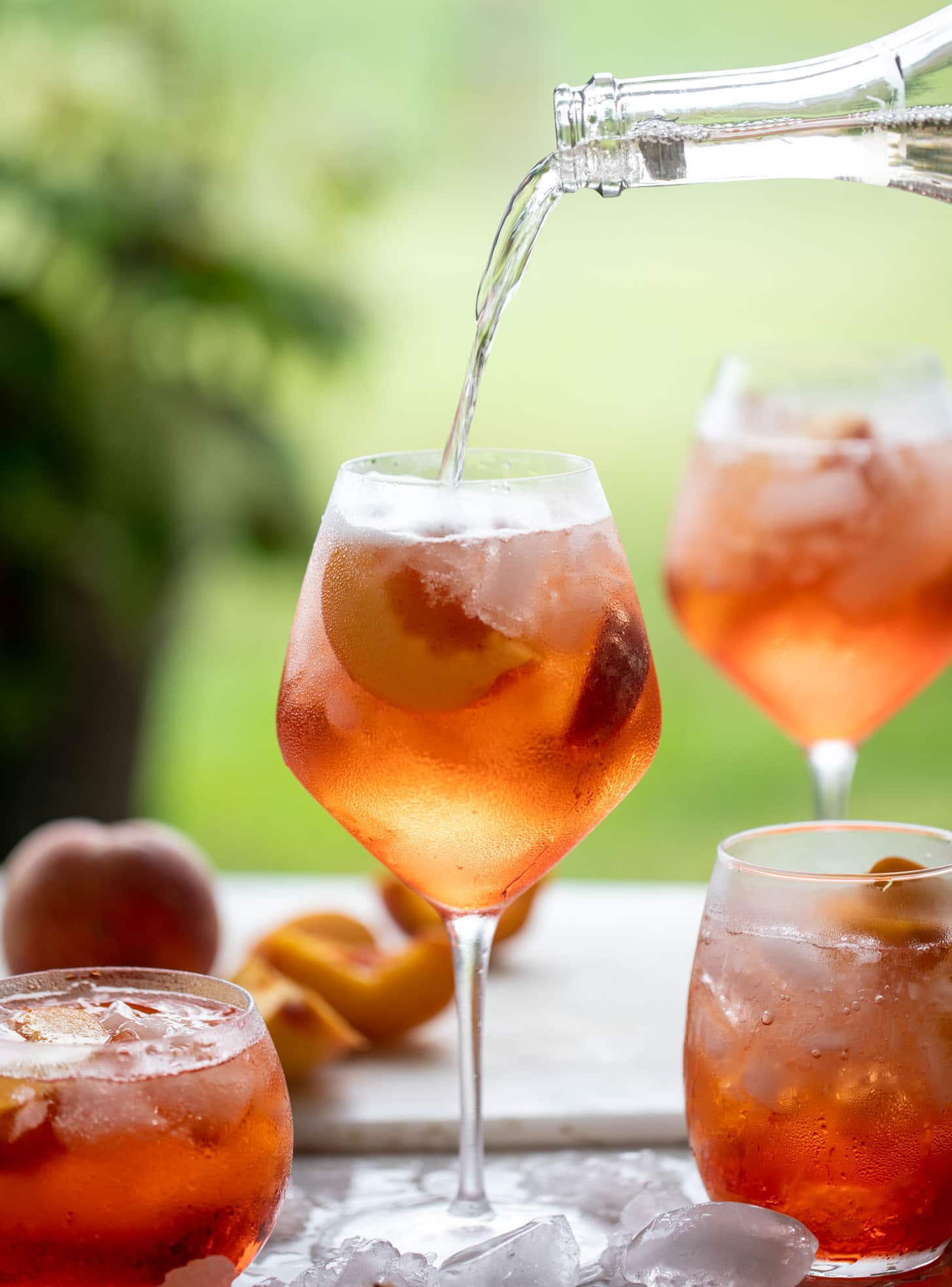 pouring sparkling rosé in aperol spritz