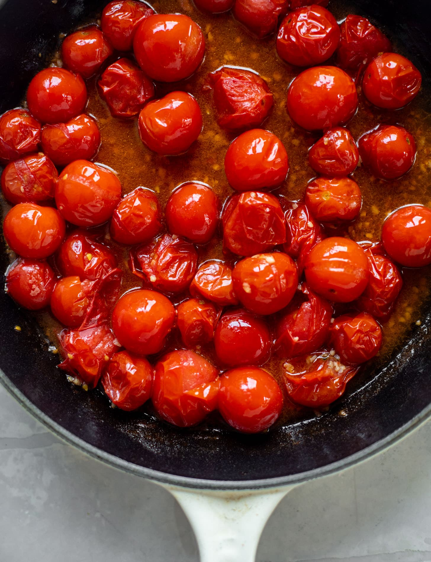burst tomatoes in a skillet