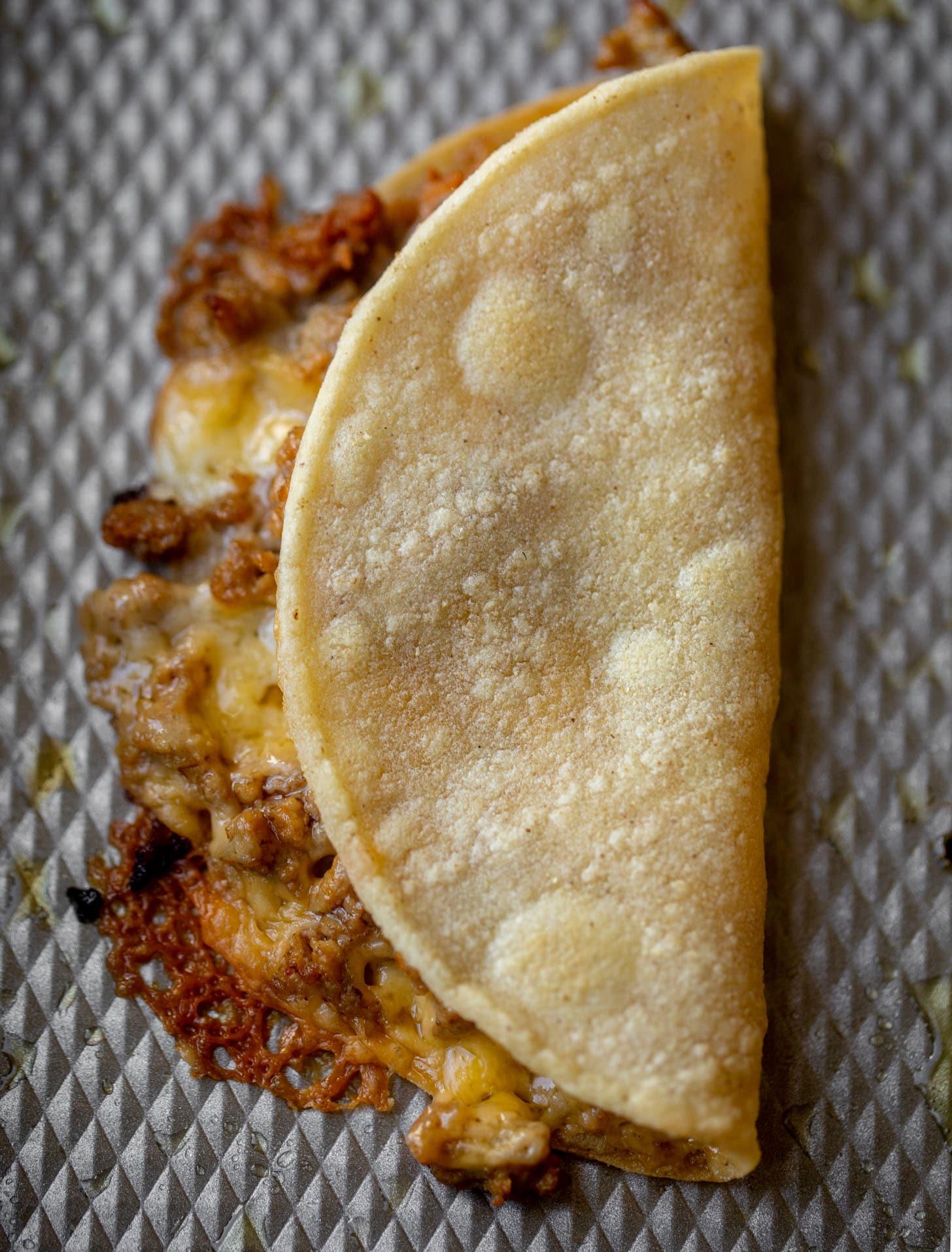 baked burger tortilla on a sheet pan