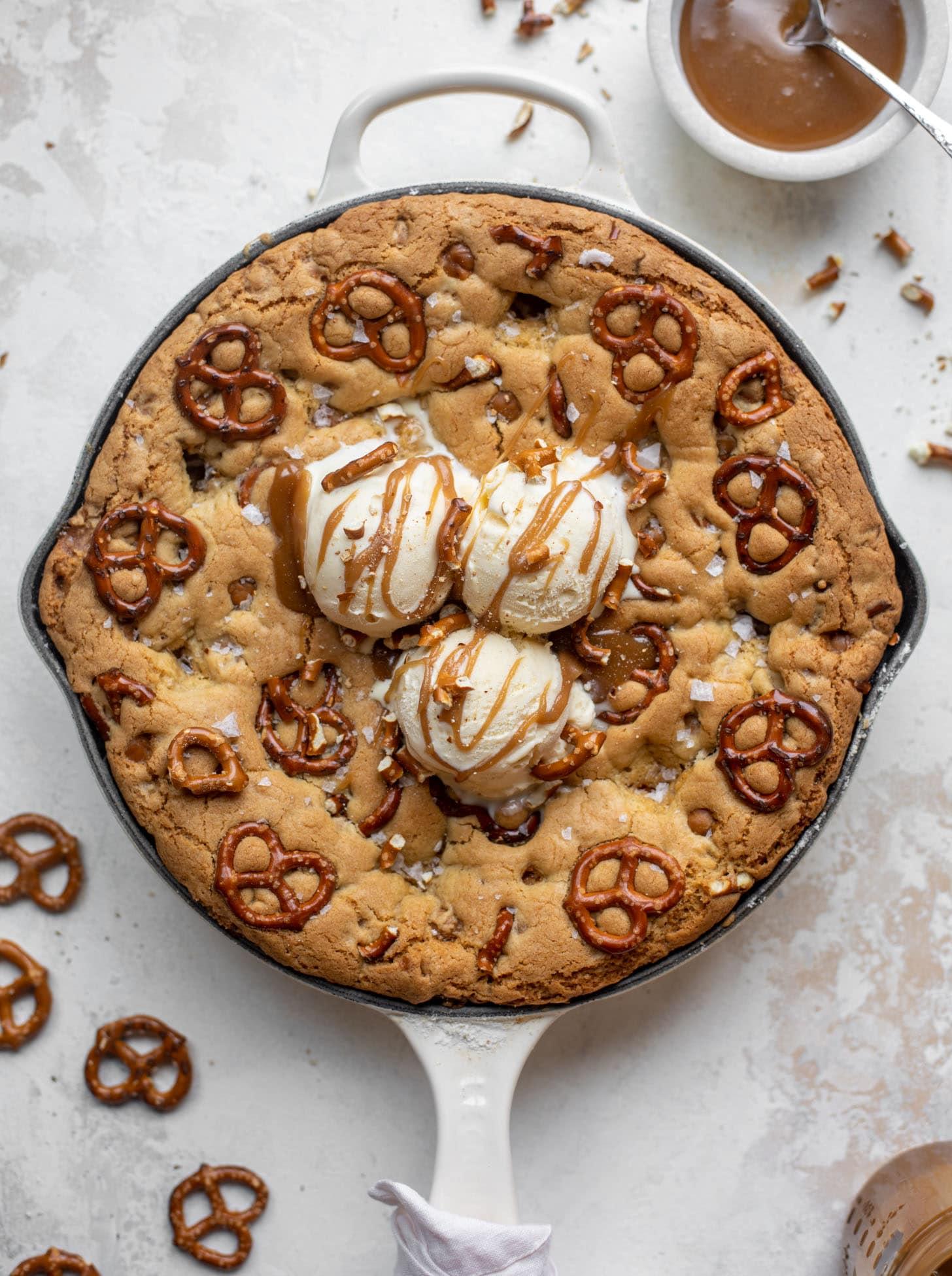 caramel pretzel skillet cookie with ice cream
